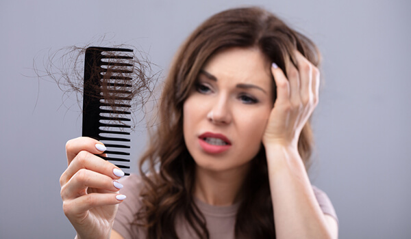 Suffering From Summer Hair Loss? 3 Tips To Protect Your Hair From Falling Out